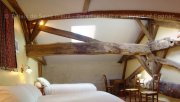 Multi-century beams in a family suite in Charente ideal for 5 people willing to experience the French way of life in a Bed and Breakfast