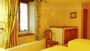 The bedroom with twin beds in a charming gite in the vineyard of Cognac located in a luxury guest house in Charente, South-West of France