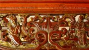 Traditional wood carving on a Chinese bed for a romantic getaway in a Bed and Breakfast near Cognac