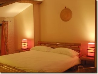 Fusion of decorative styles from Charente and Bali in a family suite in Charente ideal for 5 people